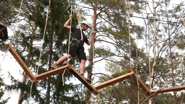 Man on High ropes course - Extreme sports
