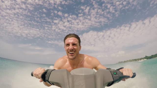 man on jet ski - acquascooter video stock e b–roll