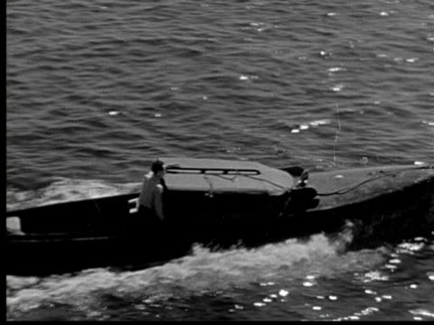 1925 ha ms cu b/w man on motorboat - 1925 stock videos & royalty-free footage