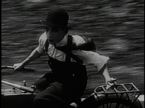 1920 montage man on motorcycle chases villain's car through streets - larry semon stock videos and b-roll footage