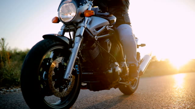 man on motorcycle in sunset - motorcycle biker stock videos & royalty-free footage