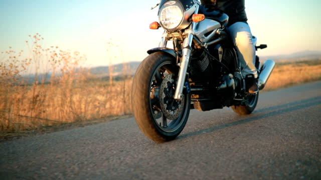 man on motorcycle in sunset - motorcycle biker stock videos and b-roll footage