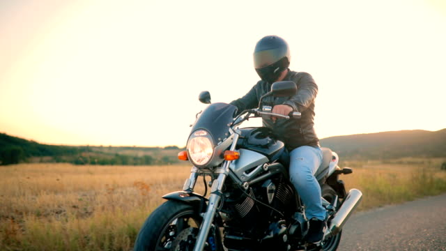 man on motorcycle in sunset - motorbike stock videos & royalty-free footage