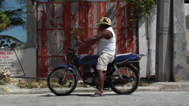 ws man on motorcycle, isla mujeres, quintana roo, mexico - quintana roo stock videos and b-roll footage