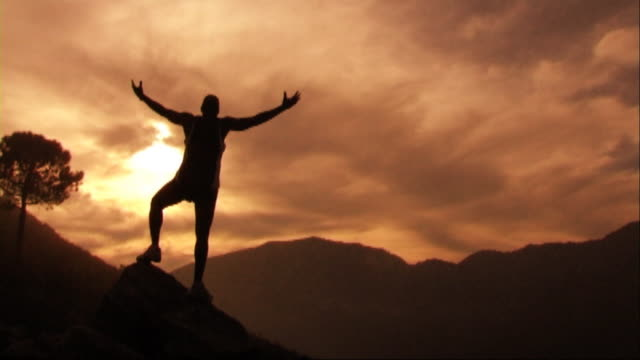 man on mountain holding out arms - arms raised stock videos & royalty-free footage