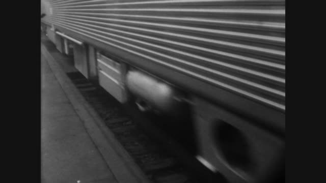 man on platform shakes hand with man on train / driver waves goodbye and new high speed train begins to move / cu driver as he looks through the... - boston massachusetts stock videos & royalty-free footage