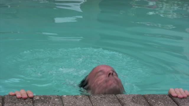 man on pool edge - utebassäng bildbanksvideor och videomaterial från bakom kulisserna