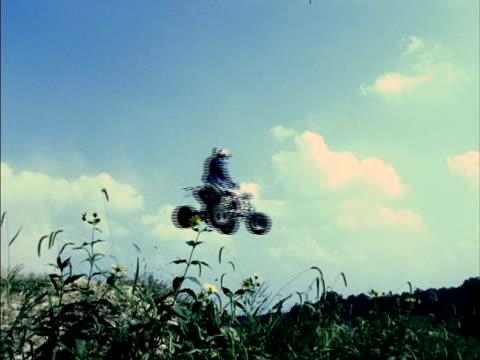 ws, la, man on quad bike jumping on meadow, california, usa - quadbike stock videos & royalty-free footage
