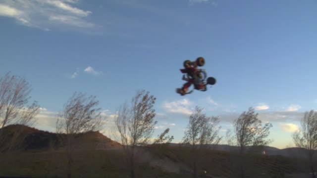 ws, man on quad bike performing somersault in air, california, usa - quadbike stock videos & royalty-free footage