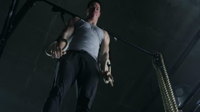 man on rings in gym - gymnastic rings stock videos & royalty-free footage