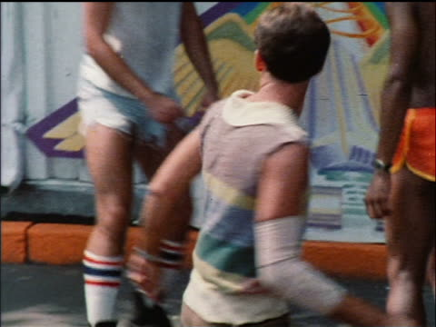 vidéos et rushes de 1978 man on roller skates dancing in busy nyc park / educational - 1978