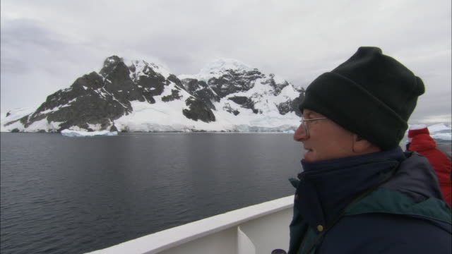 CU, Man on ship looking at Antarctic landscape, Antarctica
