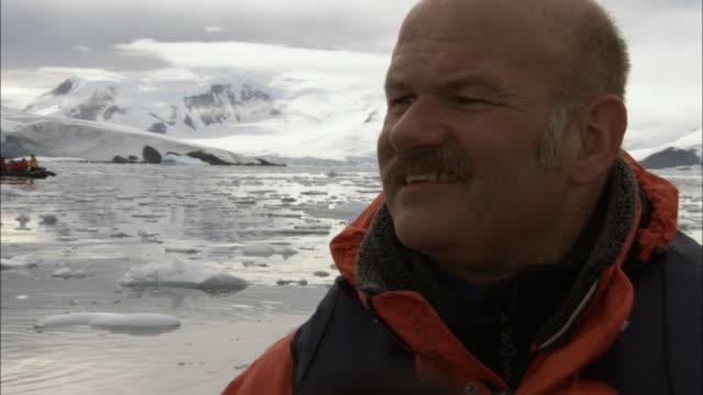 CU, Man on ship looking at Antarctic landscape, Paradise Bay, Antarctica