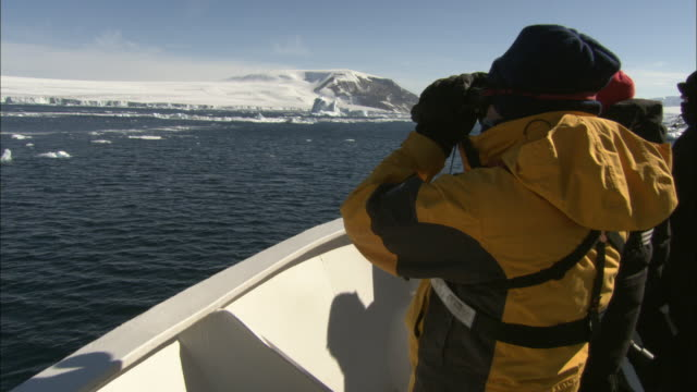 cu, man on ship looking through binoculars, antarctica - ship's bow stock videos & royalty-free footage