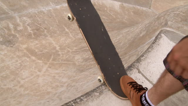 slo mo cu ws man on skateboard dropping in at edge of bowl, jacksonville, florida, usa - sports helmet stock videos & royalty-free footage