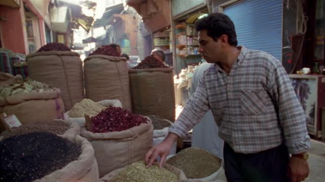 ms, pan, man on street market, cairo, egypt, - cairo stock videos & royalty-free footage