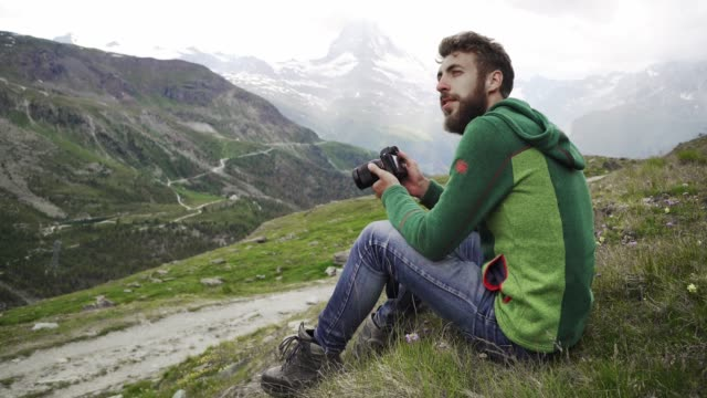 man on the background of scenic  view on  matterhorn mountain - beard stock videos & royalty-free footage