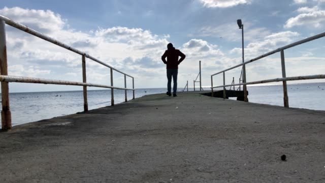 man on the edge of pier - vignette stock videos & royalty-free footage