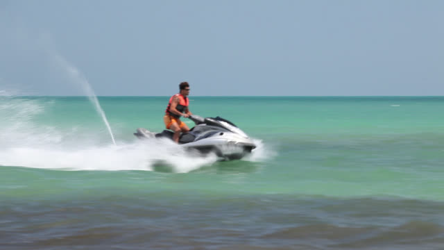 man on the jet ski - acquascooter video stock e b–roll