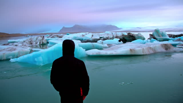Man on the shore of Jokulsarlon lagoon