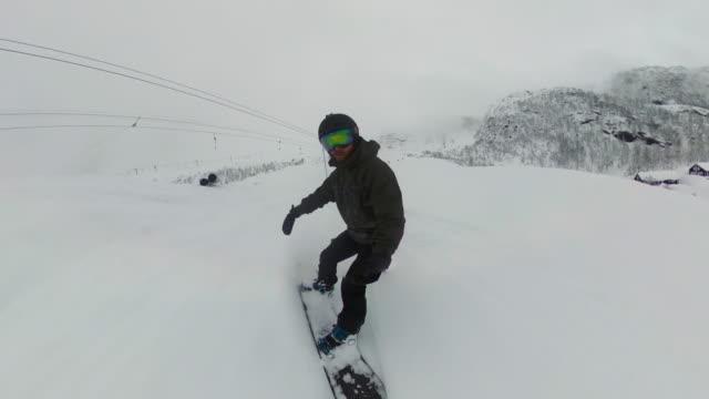 pov man on the snowboard on a ski slope:winter holidays - casco da motociclista video stock e b–roll