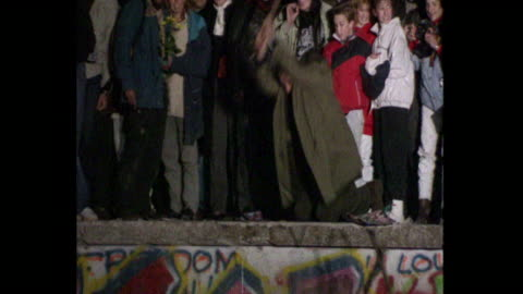 man on top of berlin wall hammering away at it, when the berlin wall fell, 1989 - falling stock videos & royalty-free footage