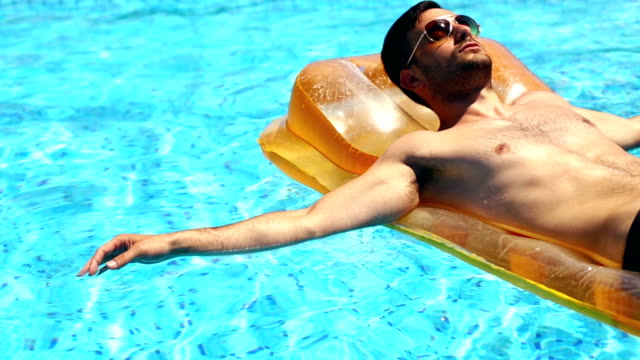 man on vacation. - pool stock videos & royalty-free footage