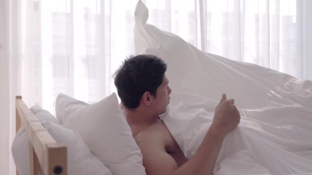 man open the window in the bedroom - human back stock videos & royalty-free footage