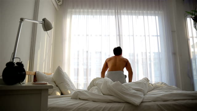 man open the window in the bedroom - waking up stock videos & royalty-free footage