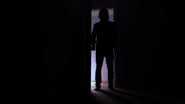 man opening a door and walking into dark room - silhouette - low stock videos & royalty-free footage