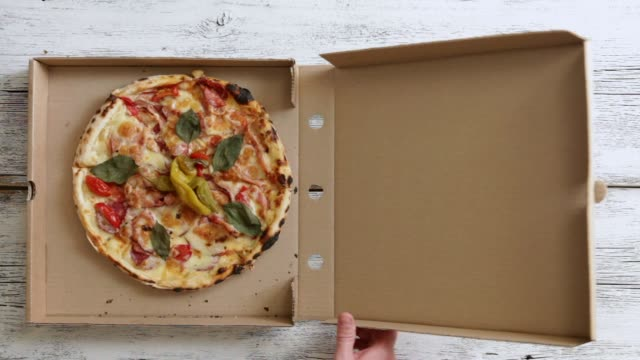 man opening box with meat pizza - delivering stock videos and b-roll footage