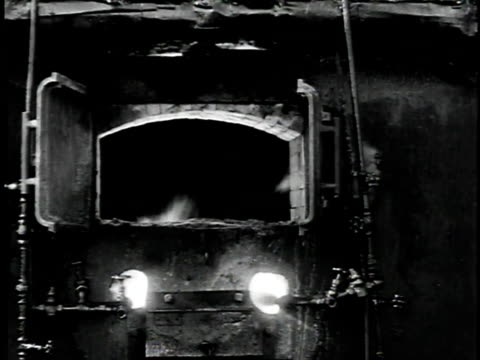 1929 montage man opening door of burning furnace /united states - 1929 stock videos and b-roll footage