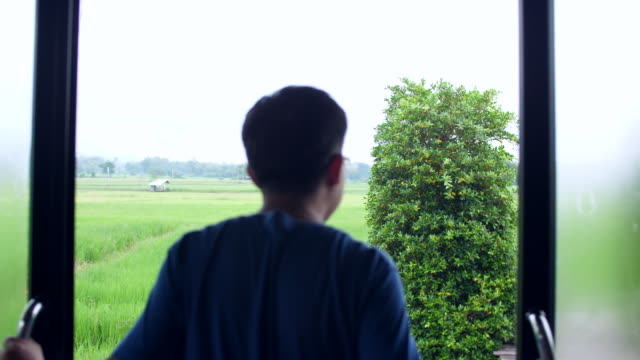 man opening door with greenery view of rice paddy - open field stock videos & royalty-free footage