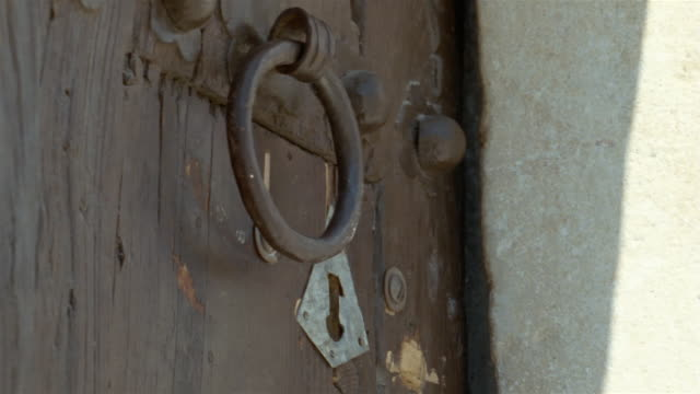 cu, man opening door with key, close up of hands, kairouan, tunisia - tunisia stock videos & royalty-free footage