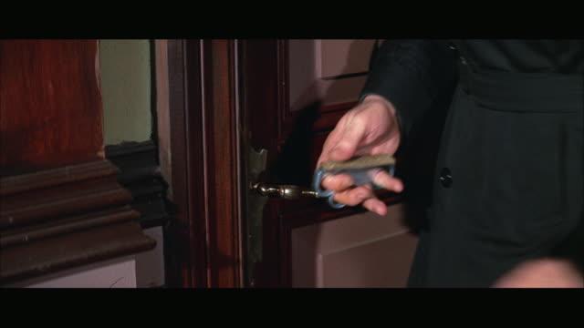 1967 CU Man opening door with knife
