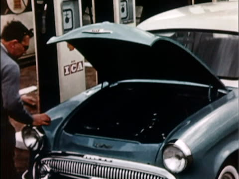 1957 ms man opening hood of 1957 hillman minx, checking engine's dipstick / united kingdom - only mid adult men stock videos & royalty-free footage