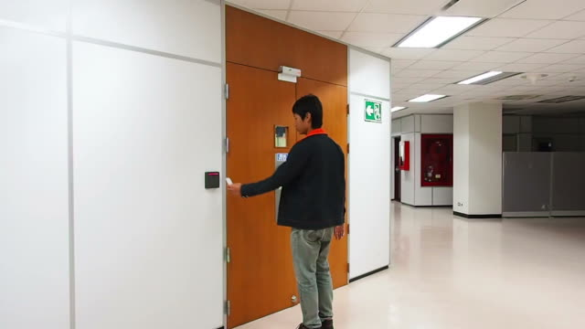 Man opening security door with access card