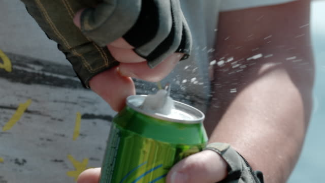 cu man opening splashing soda can - soda stock videos & royalty-free footage