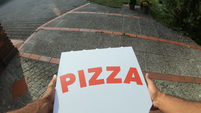 pov man opening the door and taking the pizza left on the porch - doorstep stock videos & royalty-free footage