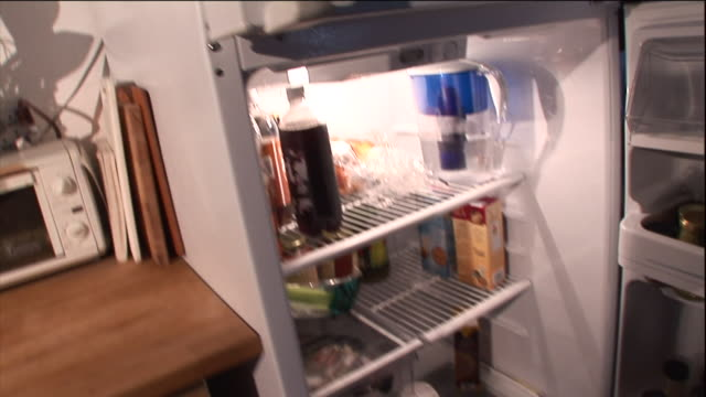 a man opens a refrigerator and removes a beverage which immediately fizzes up. - microwave stock videos & royalty-free footage
