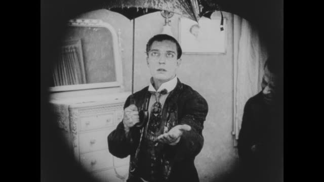 1920 man (buster keaton) opens an umbrella when the roof begins to leak - leaking stock videos & royalty-free footage