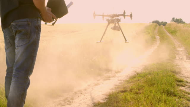 ds man operating a drone to take off - helicopter stock videos and b-roll footage