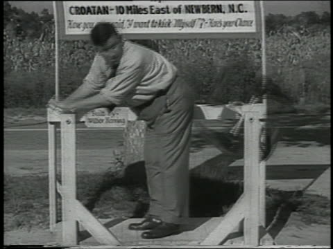 b/w 1938 man operating buttocks-kicking contraption - erfindung stock-videos und b-roll-filmmaterial
