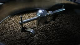 Man Operating coffee beans Roasting Machine