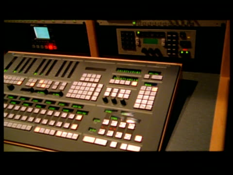 cu, pan, man operating control panel - letterbox format stock videos & royalty-free footage