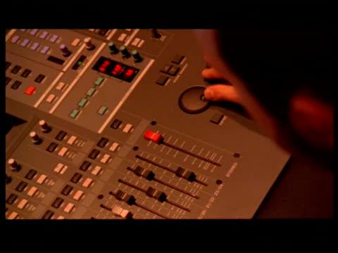 vídeos de stock, filmes e b-roll de cu, man operating control panel - formato letterbox