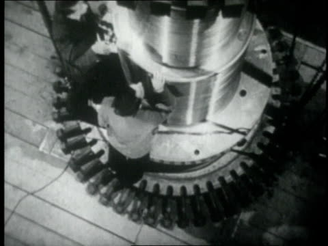 1920 montage man operating cyclotron and creating lightning - science stock videos & royalty-free footage