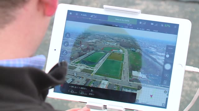 WGN Man Operating Drone Remote Control on December 22 2015 in Chicago