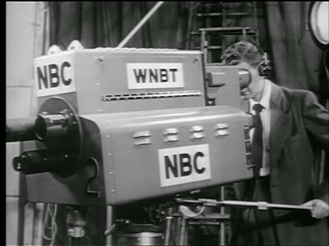 "b/w 1948 man operating large television camera with ""nbc"" labels on it - nbc stock videos & royalty-free footage"