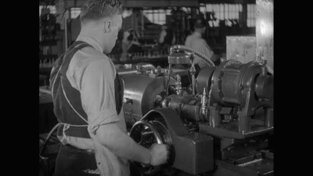 MS Man operating machine in factory / United States